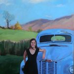 girl in front of antique car