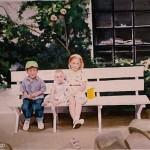 little kids sitting on bench portrait